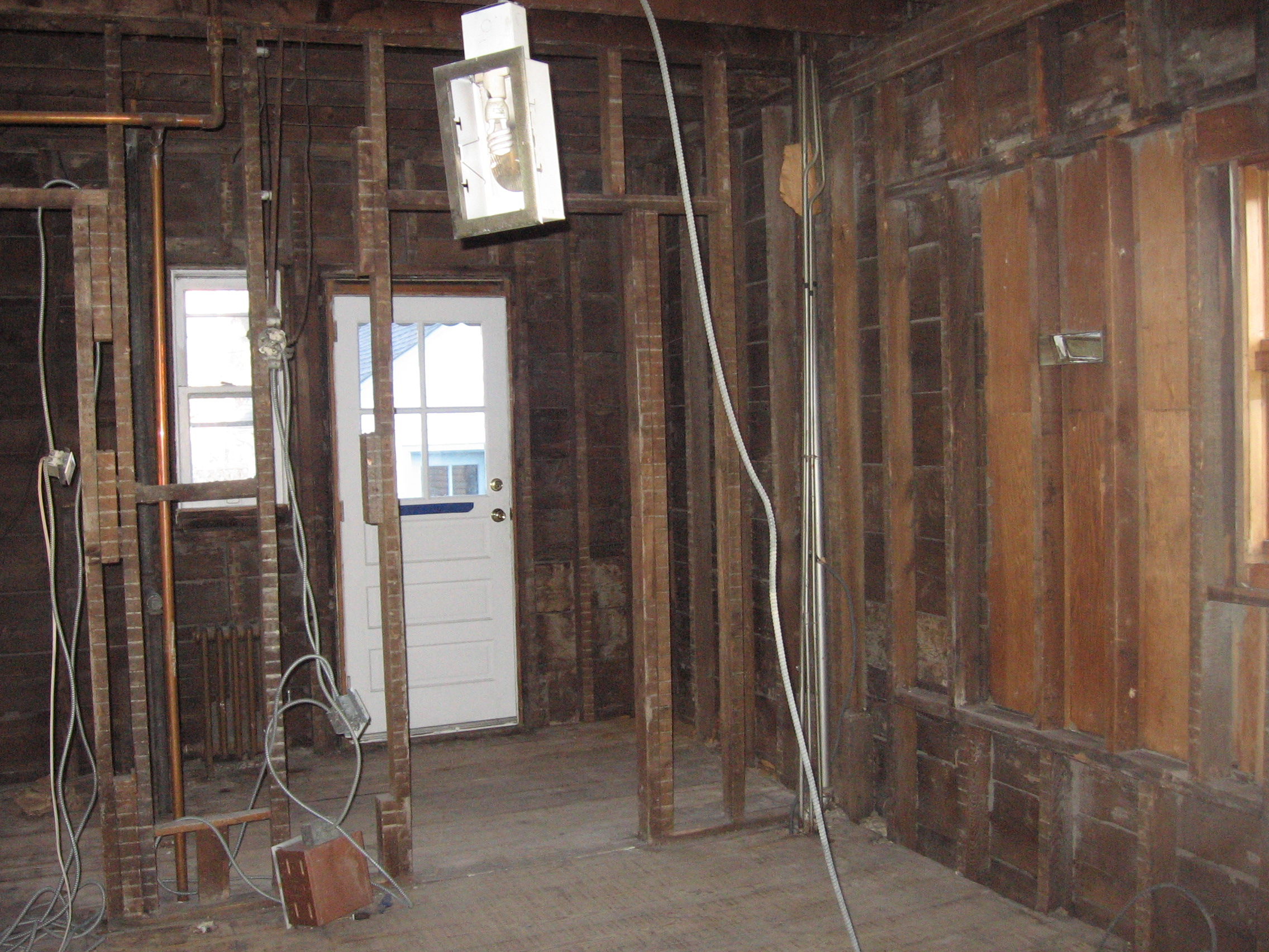 This Old House Part Two Apt 11d Rewiring An Plaster Walls Then The Guys Rewired Place Put In Lights Cabinets Three Windows They New Back Steps And A Backdoor Repaired Some Surprising